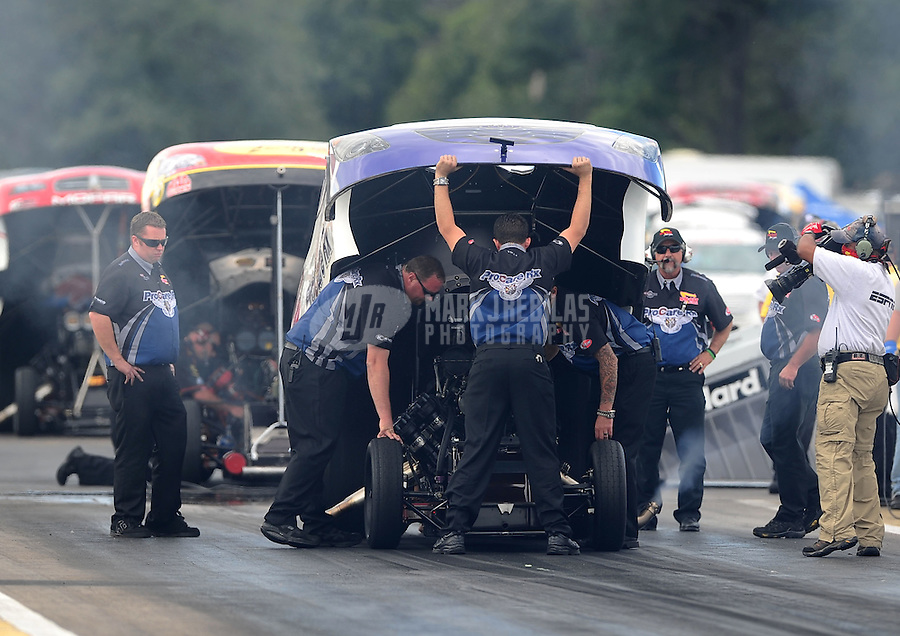 Aug. 19, 2011; Brainerd, MN, USA: NHRA crew members for funny car driver Melanie Troxel during qualifying for the Lucas Oil Nationals at Brainerd International Raceway. Mandatory Credit: Mark J. Rebilas-