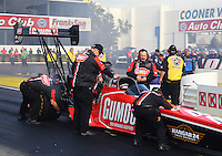 Feb 7, 2014; Pomona, CA, USA; Crew members prepare NHRA top fuel dragster driver Leah Pritchett for a qualifying run during qualifying for the Winternationals at Auto Club Raceway at Pomona. Mandatory Credit: Mark J. Rebilas-