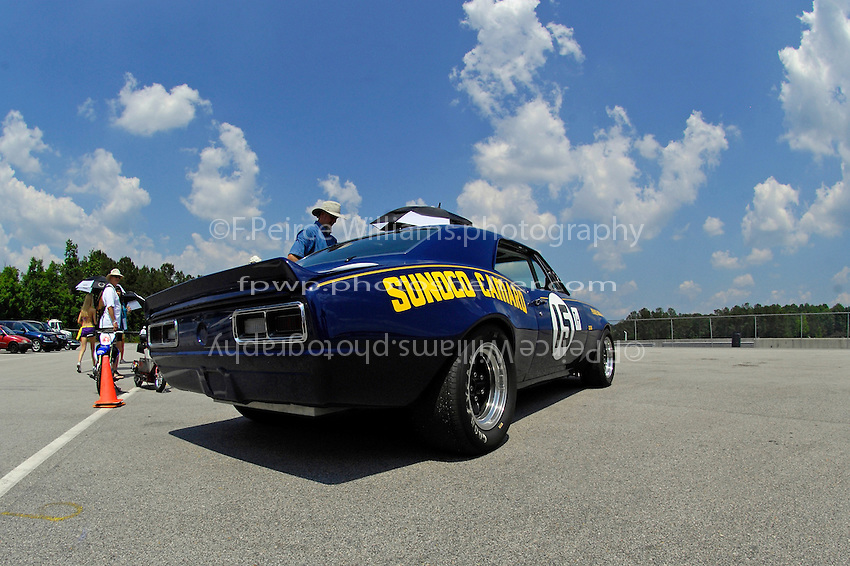 Patrick Ryan, #15 (1967 ex-Penske Racing Chevrolet Camaro, Trans Am class) on the grid.