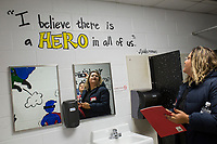 NWA Democrat-Gazette/CHARLIE KAIJO Bani Lopez of Rogers and Karla Magarin of Rogers (right) admire inspirational messages on the walls of the bathroom on Thursday, November 9, 2017 at Eastside Elementary School in Rogers. The school hosted its Leadership Day, a chance for students to showcase how they live by The 7 Habits of Highly Successful People by Stephen R. Covey through an initiative called Leader in Me.