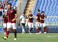 Calcio, Serie A: Roma vs Sassuolo. Roma, stadio Olimpico, 20 settembre 2015.<br /> Roma&rsquo;s Francesco Totti, third from right right, celebrates with teammates after scoring during the Italian Serie A football match between Roma and Sassuolo at Rome's Olympic stadium, 20 September 2015.<br /> UPDATE IMAGES PRESS/Isabella Bonotto