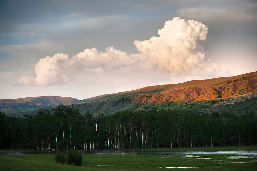 A cloud rises over the surrounding landscape in Park County, Montana.