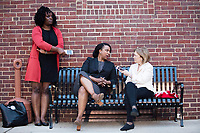 """New York Times reporter Katharine Q. """"Kit"""" Seelye (right) speaks with Ayanna Pressley, who is running in the Democratic primary Massachusetts 7th Congressional District against incumbent Mike Capuano. Pressley is currently serving as a member of the Boston City Council, and is the first woman of color elected to the Council. They are seen here with campaign team members outside the Chelsea Senior Center after speaking at an event put on by Chelsea Black Community in Chelsea, Massachusetts, USA, on Wed., June 27, 2018."""