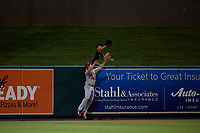 Palm Beach Cardinals left fielder Bryce Denton (25) and a young fan attempt to catch a game winning home run during a Florida State League game against the Lakeland Flying Tigers on April 17, 2019 at Publix Field at Joker Marchant Stadium in Lakeland, Florida.  Lakeland defeated Palm Beach 1-0.  (Mike Janes/Four Seam Images)