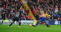 Lincoln City's John Akinde, under pressure from Mansfield Town's Krystian Pearce, sees his shot saved by Mansfield Town's Robert Olejnik<br /> <br /> Photographer Chris Vaughan/CameraSport<br /> <br /> The EFL Sky Bet League Two - Lincoln City v Mansfield Town - Saturday 24th November 2018 - Sincil Bank - Lincoln<br /> <br /> World Copyright &copy; 2018 CameraSport. All rights reserved. 43 Linden Ave. Countesthorpe. Leicester. England. LE8 5PG - Tel: +44 (0) 116 277 4147 - admin@camerasport.com - www.camerasport.com