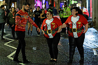 Pictured: Three female Christmas revellers in Wind Street, Swansea, Wales, UK. Friday 20 December 2019<br /> Re: Black Eye Friday (also known as Black Friday, Mad Friday, Frantic Friday) the last Friday before Christmas, in Swansea, Wales, UK.