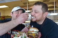Greg and Chris Skillas with a custom hamburger.