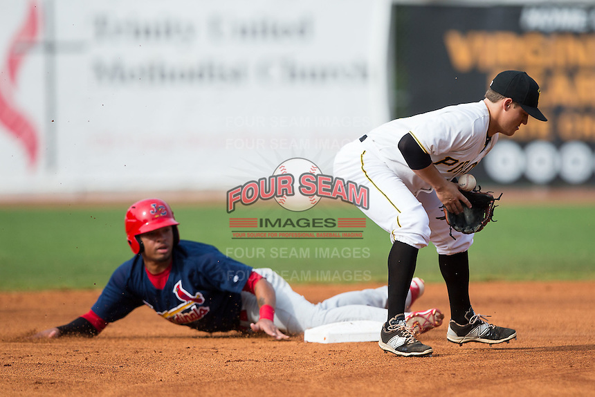 Bristol Pirates shortstop Logan Ratledge (25) blocks a throw as Edmundo Sosa (19) of the Johnson City Cardinals slides into second base at Boyce Cox Field on July 7, 2015 in Bristol, Virginia.  The Cardinals defeated the Pirates 4-1 in game one of a double-header. (Brian Westerholt/Four Seam Images)