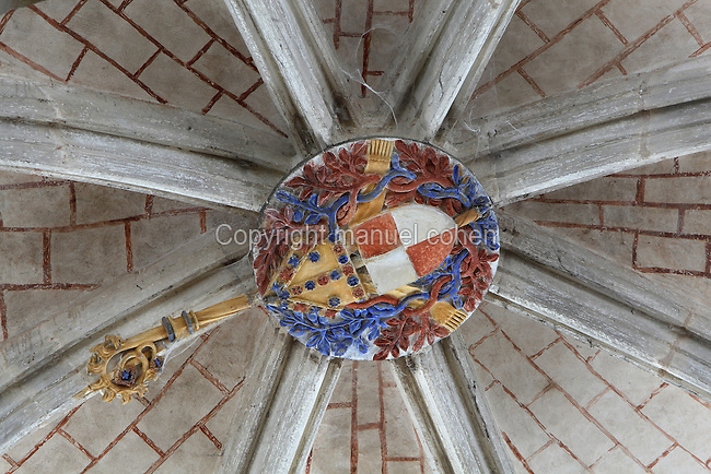 Coat of arms of Louis de Crevant, abbot of Conques 1482-96, on the keystone of the lantern tower, built on the junction of the nave and transept after the collapse of the original cupola, in the Abbatiale Sainte-Foy de Conques or Abbey-church of Saint-Foy, Conques, Aveyron, Midi-Pyrenees, France, a Romanesque abbey church begun 1050 under abbot Odolric to house the remains of St Foy, a 4th century female martyr. The church is on the pilgrimage route to Santiago da Compostela, and is listed as a historic monument and a UNESCO World Heritage Site. Picture by Manuel Cohen