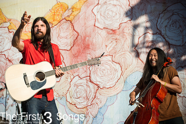 Joe Kwon and Seth Avett of The Avett Brothers perform during Day 1 of the 2013 Firefly Music Festival in Dover, Delaware.