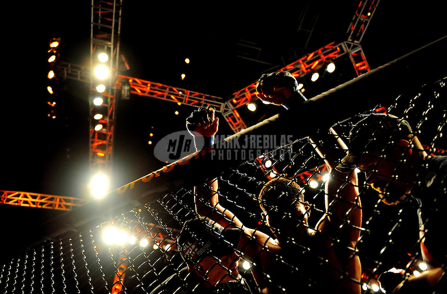 Jan. 31, 2009; Las Vegas, NV, USA; UFC fighter Jon Jones leans against the cage against Stephan Bonnar (not pictured) during the light heavyweight swing bout in UFC 94 at the MGM Grand Hotel and Casino. Mandatory Credit: Mark J. Rebilas-