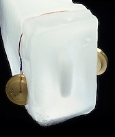 WEIGHTED WIRE CUTS THROUGH BLOCK OF ICE<br /> Regelation of Ice<br /> The pressure exerted on the ice by the weighted wire lowers the melting point of ice causing it to liquefy under the wire.