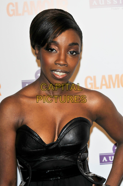 ESTELLE .Glamour Women of the Year Awards 2008.inside arrivals at Berkeley Square Gardens, London, England  3rd June 2008.half length black strapless leather cleavage .CAP/PL.©Phil Loftus/Capital Pictures