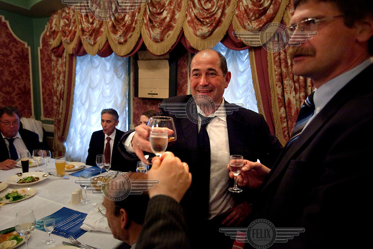 American-Ukrainian physicist Igor Bolshinsky dine with Kazakh nuclear physicists to celebrate the removal of highly enriched uranium (HEU) at the Institute of Nuclear Physics in Almaty. The removal of Kazakhstan's HEU is part of the U.S. Global Threat Reduction Initiative (GTRI), where Bolshinsky works, which tries to secure nuclear material around the world to prevent their misuse.