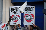 © Joel Goodman - 07973 332324 . 11/01/2014 . Tottenham , London , UK . Doves of peace are released . Campaigners hold a vigil in memory of Mark Duggan outside Tottenham Police Station this afternoon (11th January 2014) . A jury found Duggan was lawfully killed by police in August 2011 . Duggan's shooting and a protest at the same location in August 2011 sparked riots and several days of looting across London and England . Photo credit : Joel Goodman
