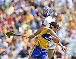 David Reidy of Clare in action against Mark Fanning of Wexford during their All-Ireland quarter final at Pairc Ui Chaoimh. Photograph by John Kelly.