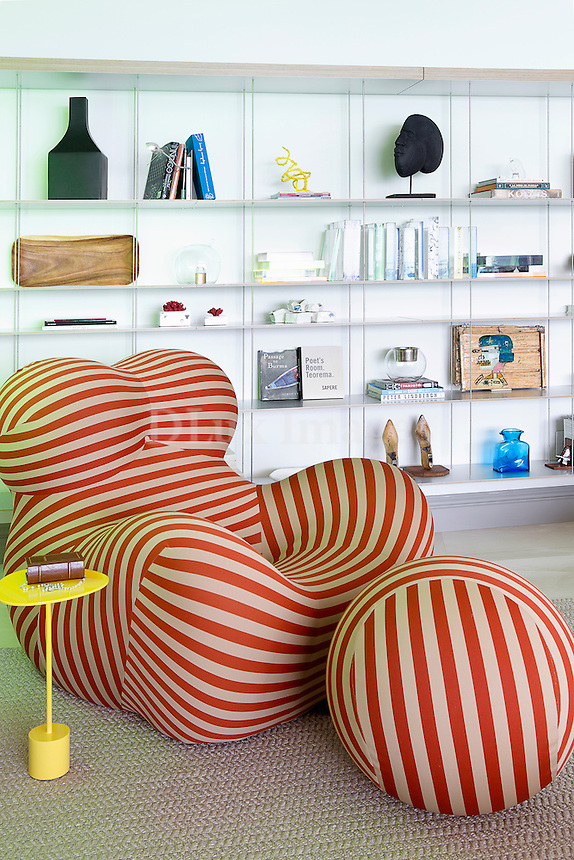 Modern red and white striped armchair and ottoman