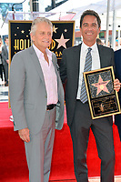 """LOS ANGELES, CA. September 13, 2018: Michael Douglas & Eric McCormack at the Hollywood Walk of Fame Star Ceremony honoring """"Will & Grace"""" star Eric McCormack."""