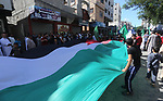 """Palestinian supporters of Hamas movement take part in a protest against the 100th anniversary of Britain's Balfour Declaration in Gaza city on November 3, 2017, which helped lead to Israel's creation and the Israeli-Palestinian conflict. Palestinian president Mahmud Abbas used the occasion to denounce the declaration, writing in a newspaper opinion piece that """"the creation of a homeland for one people resulted in the dispossession and continuing persecution of another"""". Photo by Mohammed Asad"""
