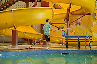 NWA Democrat-Gazette/ANTHONY REYES &bull; @NWATONYR<br /> Jacob Carnes, lifeguard at the Jones Center, cleans the deck Tuesday, Sept. 8, 2015 around the leisure pool at the Jones Center in Springdale. The pool was recently refinished and is now open to the public during its regular pool schedule. A grand opening for the pool will be 10 a.m. on Friday.