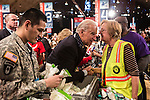 Vice President Joseph R. Biden, center, greets Hilda Perez, right, of Washington, DC, during the National Day of Service at the Unite America in Service event at the DC Armory on Saturday, January 19, 2013 in Washington, DC.