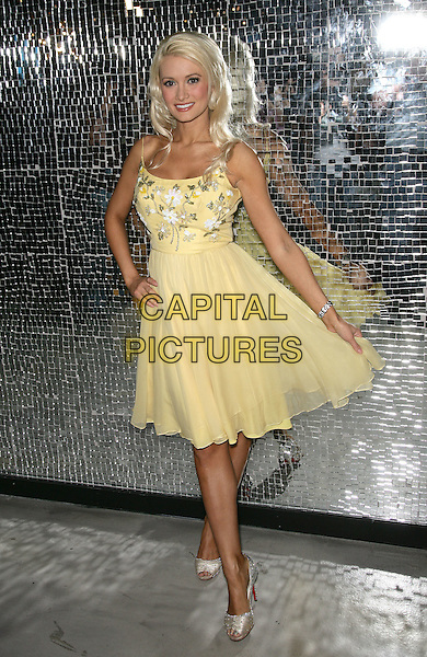 HOLLY MADISON  .Holly Madison and the Stunning Cast of Peepshow Celebrate 1st Anniversary at Planet Hollywood Resort and Casino,.Las Vegas, Nevada, USA..full length yellow dress silver shoes .CAP/ADM/MJT.© MJT/AdMedia/Capital Pictures.