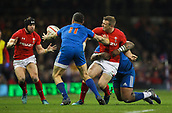 17th March 2018, Principality Stadium, Cardiff, Wales; NatWest Six Nations rugby, Wales versus France; Hadleigh Parkes of Wales offloads to Leigh Halfpenny after getting tackled by Mathieu Bastareaud of France