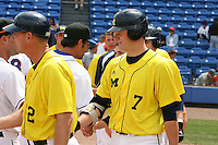 March 21, 2010:  First Baseman Mike Dufek (7)) of the Michigan Wolverines shakes hands after a game at Tradition Field in St. Lucie, FL.  Photo By Mike Janes/Four Seam Images