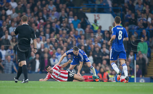 03.10.2015. London, England. Barclays Premier League. Chelsea versus Southampton. Southampton's Graziano Pellè is fouled by Chelsea's Gary Cahill.