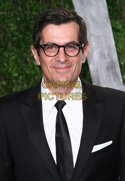 Ty Burrell.2012 Vanity Fair Oscar Party held at the Sunset Tower, West Hollywood, California, USA..February 26th, 2012.headshot portrait black suit white shirt tie glasses   .CAP/ADM/FS.©Faye Sadou/AdMedia/Capital Pictures.