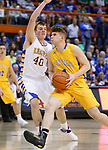 RAPID CITY, SD - MARCH 18, 2017 -- Christian Goetz #4 of Aberdeen Central drives on Jaron Zwagerman #40 of Sioux Falls O'Gorman during the 2017 South Dakota State Class AA Boys Basketball Championship game Saturday at Barnett Arena in Rapid City, S.D.  (Photo by Dick Carlson/Inertia)