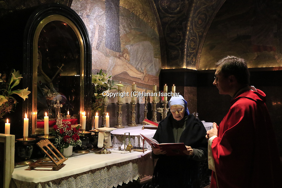 Israel, Jerusalem Old City, a prayer by the Thirteenth Station of the Via Dolorosa at the Church of the Holy Sepulchre
