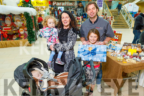 Alannah Crossin, Ann Moore, Danny Rose and Bobby Murphy and Benoit Lorge from Kenmare Chocolates at the Manor West Shopping Centre's Annual Christmas Food & Craft Fair on Saturday.