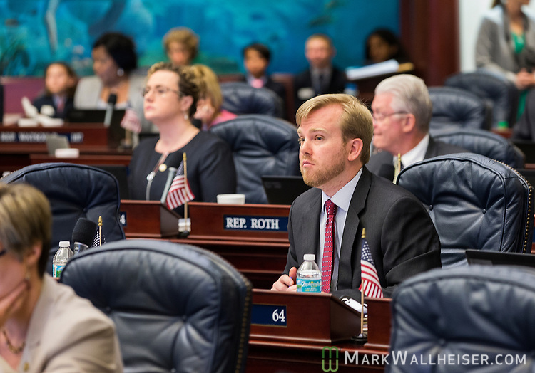 Rep. James Grant, R-Tampa, listens during Florida House of Representatives floor debate at the Florida Capitol in Tallahassee, Florida.
