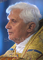 Pope Benedict XVI takes part in a candlelit Corpus Domini procession between the basilicas San Giovanni in Laterano and Santa Maria Maggiore in Rome May 22, 2008..