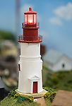 Hicksville, New York, USA. February 22, 2015. A model Light House, red and white and built from scratch, is one of the scenes at the Model Train Exhibit hosted by Trainville Hobby Depot at the Broadway Mall. Donations were accepted at exhibit to support the Nassau County Empire State Games for the Physically Challenged.