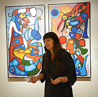 NWA Democrat-Gazette/ANDY SHUPE<br /> Independent curator Candice Hopkins speaks Thursday, Oct. 4, 2018, about a painting by artist Norval Morrisseau titled, &quot;The Story Teller: The Artist and His Grandfather,&quot; during a tour of a new exhibition of artwork by Native American artists at Crystal Bridges Museum of American Art in Bentonville. The exhibition, titled &quot;Art for a New Understanding: Native Voices, 1950s to Now,&quot; opens today and runs through Jan. 7, 2019.