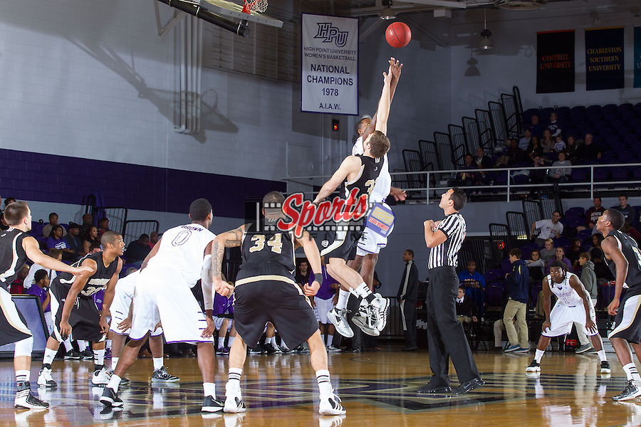 Allan Chaney (13) of the High Point Panthers battles for the opening tip against CJ Neumann (31) of the Wofford Terriers at Millis Athletic Center on November 24, 2013 in High Point, North Carolina.  The Panthers defeated the Terriers 66-56.   (Brian Westerholt/Sports On Film)