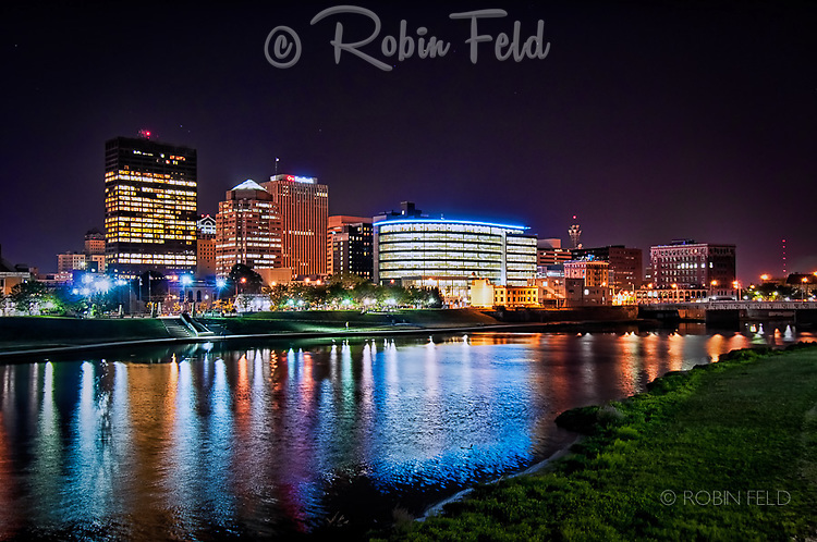 Dayton Ohio Skyline at night with river, north-east view from bank, show is cityscape of Downtown Dayton Ohio