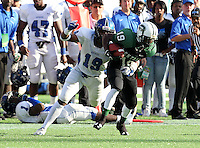 Armwood Hawks linebacker Eric Striker #19 tackles wide receiver Travius Brown #19 (green) after a reception during the fourth quarter of the Florida High School Athletic Association 6A Championship Game at Florida's Citrus Bowl on December 17, 2011 in Orlando, Florida.  Armwood defeated Miami Central 40-31.  (Mike Janes/Four Seam Images)