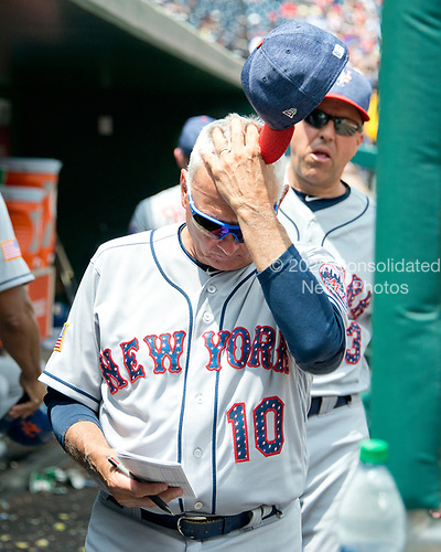 New York Mets manager Terry Collins (10) looks at his line-up card as his team takes the field in the eighth inning against the Washington Nationals at Nationals Park in Washington, D.C. on Tuesday, July 4, 2017.  The Nationals won the game 11 - 4.<br /> Credit: Ron Sachs / CNP<br /> (RESTRICTION: NO New York or New Jersey Newspapers or newspapers within a 75 mile radius of New York City)