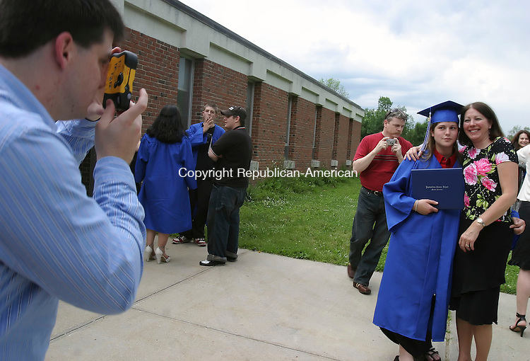 TORRINGTON, CT 6/16/07- 061607BZ16- Mike Marciano, of Torrington, takes a picture of his girlfriend Amanda Rossi, of Litchfield, and her mother Sally Rossi, after commencement excercises for Explorations Charter School Saturday.<br /> Jamison C. Bazinet Republican-American