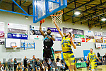 Keith Jumper, centre for Garvey's Tralee Warriors raised the roof when he got way up to Dunk the ball when his side met UCD Marian last Saturday night at Tralee sports complex in the first game of the new season.
