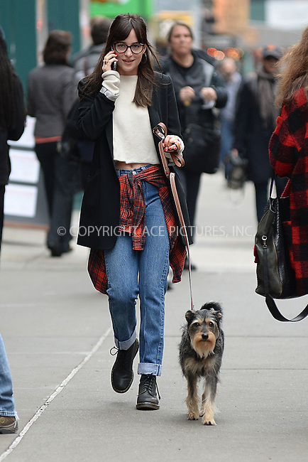 WWW.ACEPIXS.COM<br /> April 9, 2015 New York City<br /> <br /> Dakota Johnson seen walking her dog in New York City on April 9, 2015.<br /> <br /> By Line: Kristin Callahan/ACE Pictures<br /> ACE Pictures, Inc.<br /> tel: 646 769 0430<br /> Email: info@acepixs.com<br /> www.acepixs.com