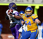 BROOKINGS, SD - OCTOBER 24:  Cole Langer #54 from South Dakota State applies pressure as Aaron Bailey #15 from University of Northern Iowa makes a pass in the first quarter of their game Saturday afternoon at Coughlin Alumni Stadium in Brookings. (Photo by Dave Eggen/Inertia)