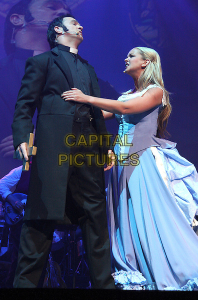 SHANNON NOLL & JENNIFER ELLISON .War Of The Worlds 'Alive on Stage' dress rehearsal at Elstree Studios, .June 4th 2009..theatre photocall full length on stage blue dress acting microphone arm tall short black costume .CAP/ROS.©Steve Ross/Capital Pictures