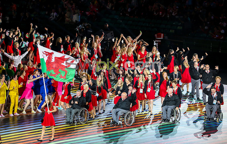 Picture by Alex Whitehead/SWpix.com - 23/07/2014 - 2014 Glasgow Commonwealth Games - Opening Ceremony - Celtic Park, Glasgow, Scotland - The Wales team lead by flag bearer Frankie Jones during the athlete parade.