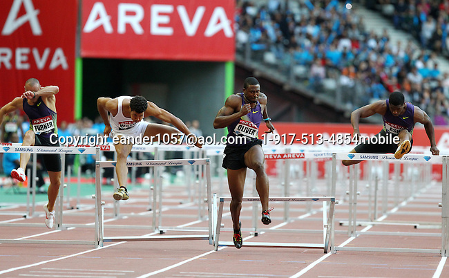 David Oliver on his way to setting an American Record in the 110m High Hurdles with a time of 12.89sec. at the Samsung Diamond League meeting in Paris, France on Friday, July 16, 2010. Photo by Errol Anderson