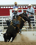 Tyler Smith scores a 77 point ride on a Southwick Rodeo Comapny bull during the Southeast Weld County CPRA Rodeo in Keenesburg, Colorado.