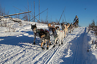Janelle Towbridge on the in-bound trail of the 2014 Jr. Iditarod Sled Dog Race at Happy Trails Kennel, Big Lake, Alaska<br /> Sunday February 23, 2014 <br /> <br /> Junior Iditarod Sled Dog Race 2014<br /> PHOTO BY JEFF SCHULTZ/IDITARODPHOTOS.COM  USE ONLY WITH PERMISSION